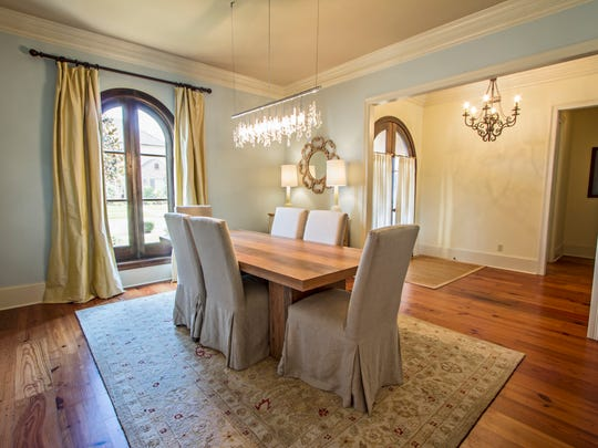 The formal dining room is elegant and soothing all at once.