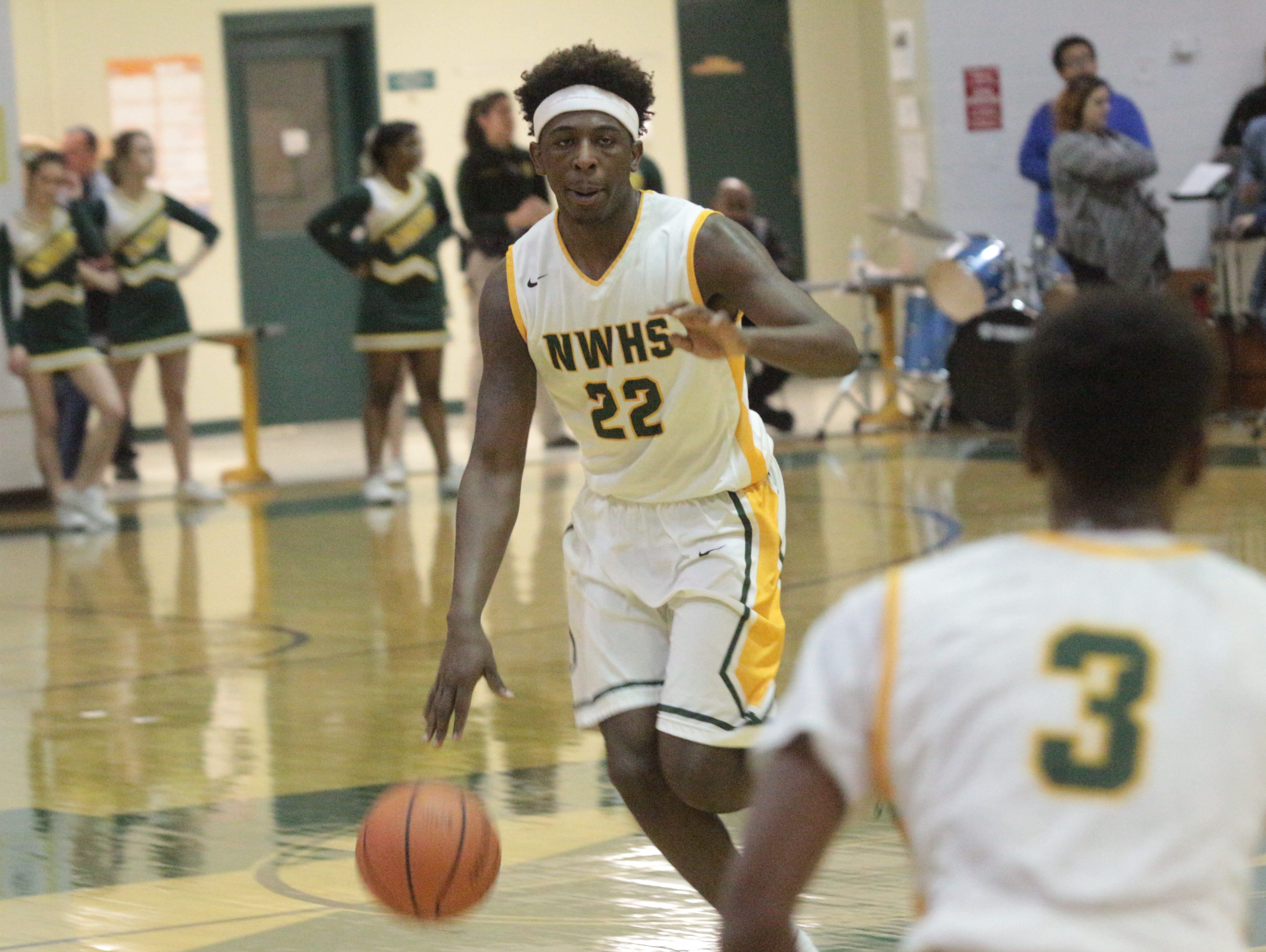 Northwest guard Tariq Silver (22) dribbles the ball up the court in the first half of the Vikings' game against the University School of Nashville Monday at Northwest High School.