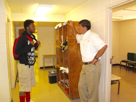 Andre Williams, left, a junior, talks with head of