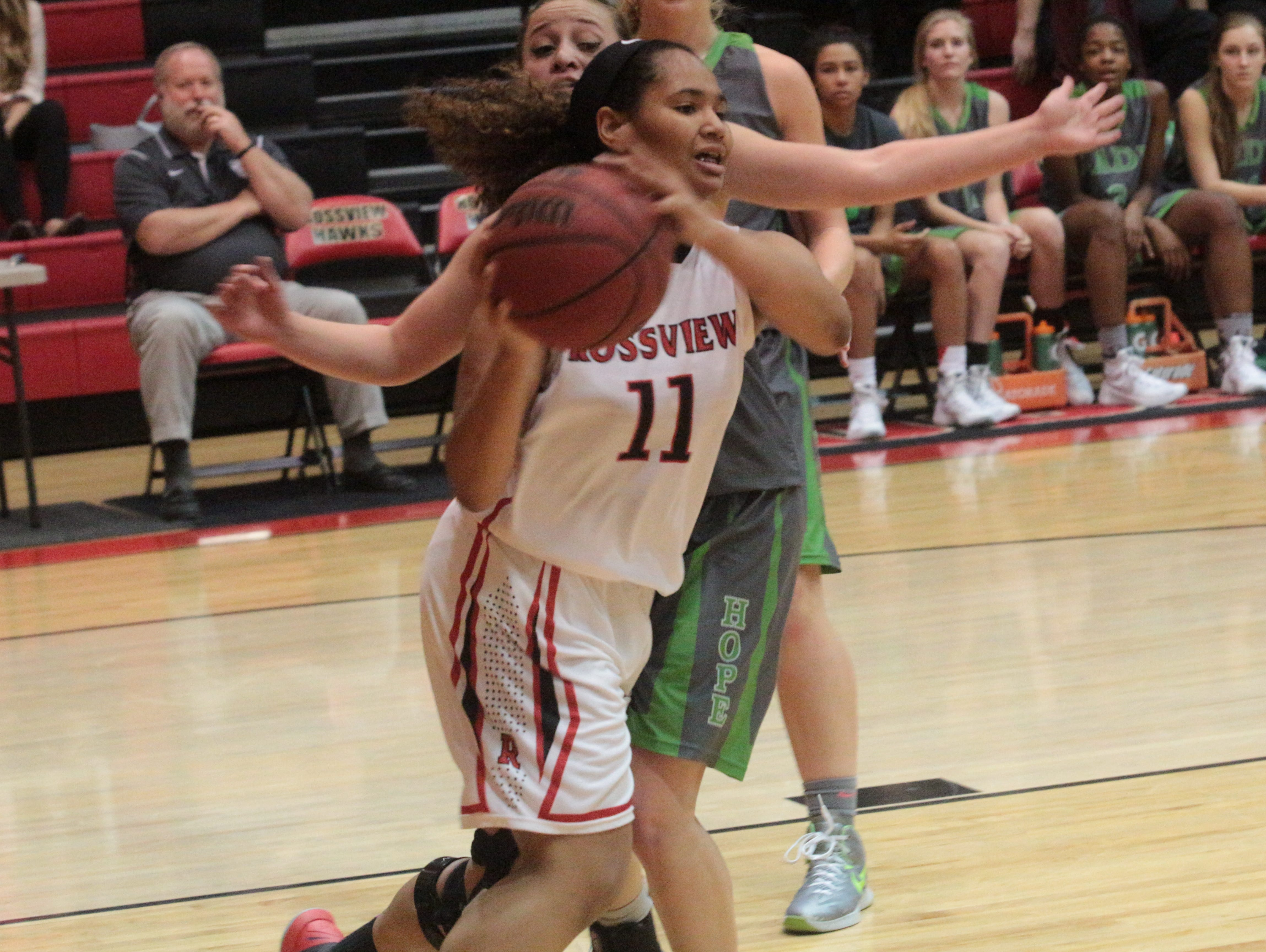 Rossview's Karle Pace (11) looks to pass the ball back out to the backcourt during the Lady Hawks' varsity game against Station Camp Tuesday night.