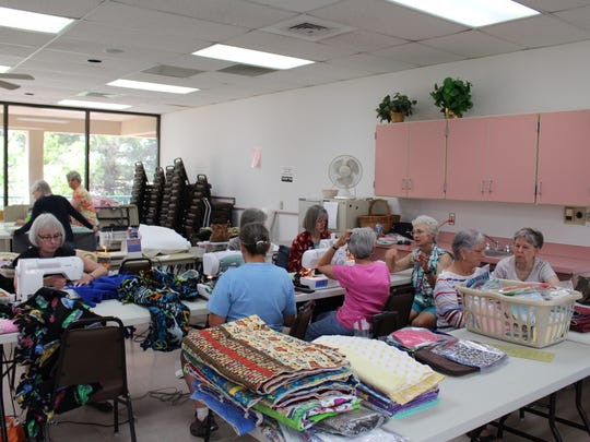 "Project Linus volunteers , known as ""blanketeers,"" work on their various projects during May's meeting at the Good Samaritan Society, 3025 Terrace Drive. Blanketeers knit, crochet, cut and tie fleece, sew quilts, manage the yarn and fabric supply and deliver blankets."
