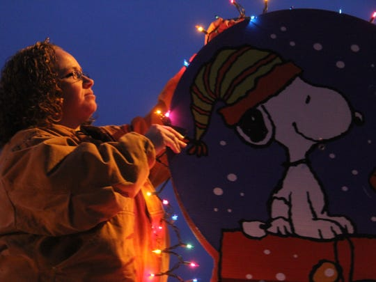 The Carlsbad Girls Scout entry into the 2015 Electric Light Parade needed a little touch up as sponsors adjusted lights on the float Saturday evening.