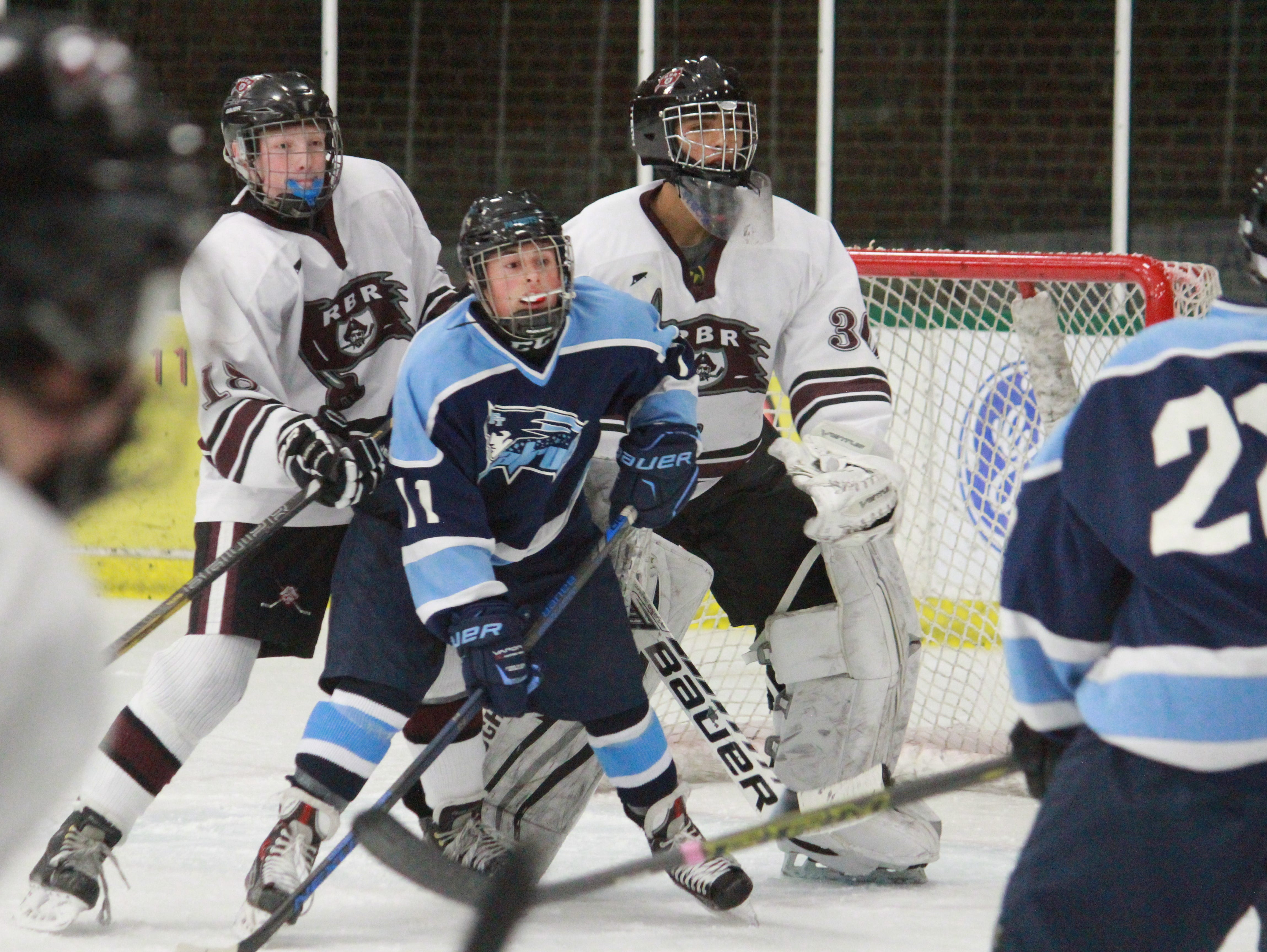 Brendan Liebross (11) battles in front of the net for Freehold Township.