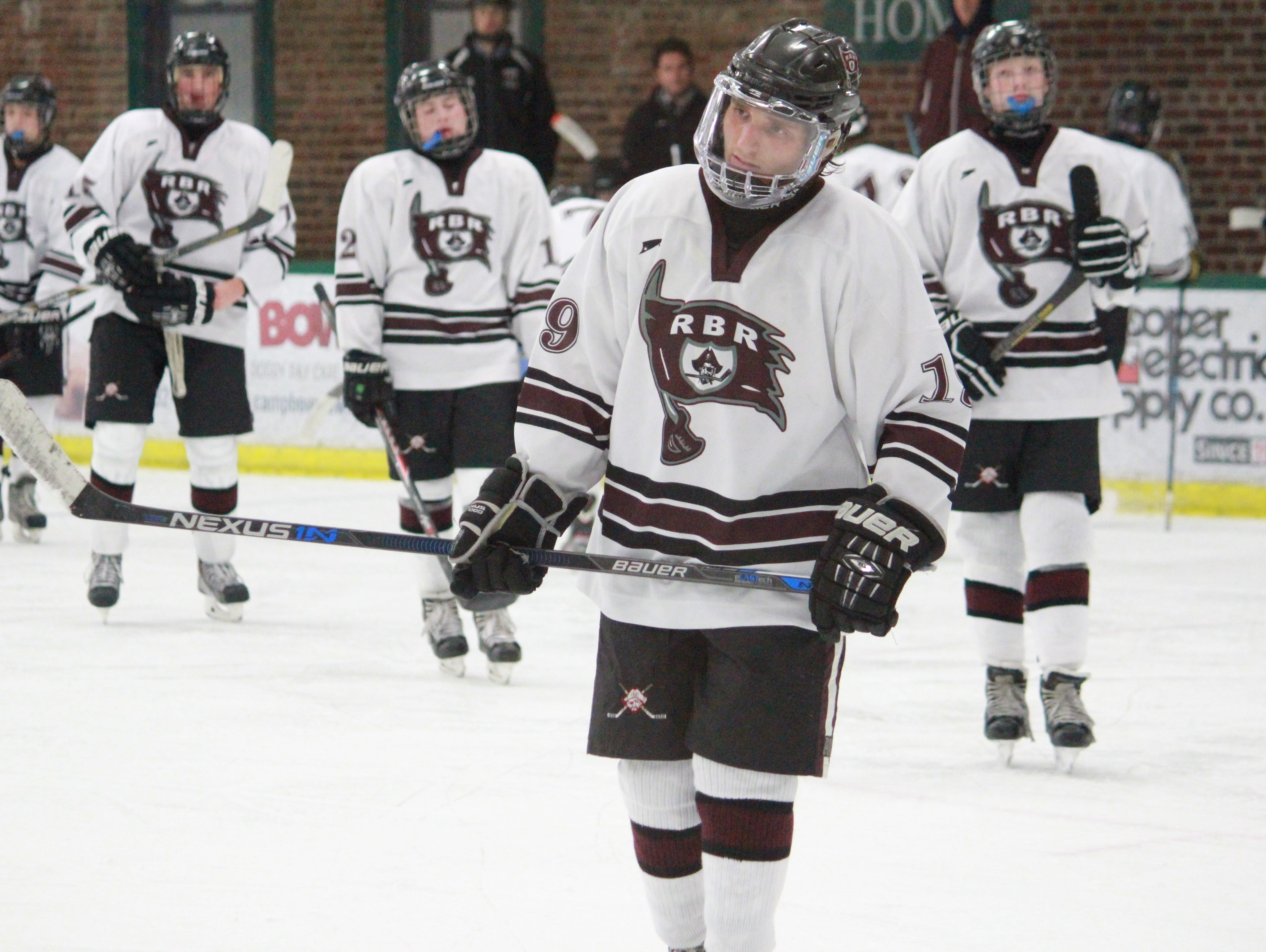 Frank Taddeo leads Red Bank Regional onto the ice.
