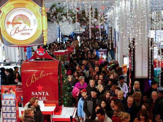 Customers stream into Macy's flagship store in Herald