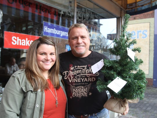 From left, Krizti  Caraway and her father Tracy ask the community to look for Dream Trees stationed around Salem.