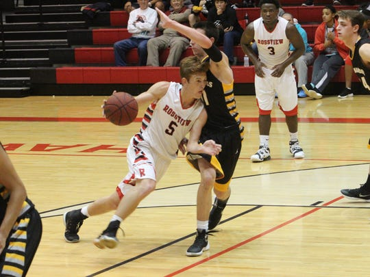 Rossview's Cannon Campbell (5) drives past a Hendersonville