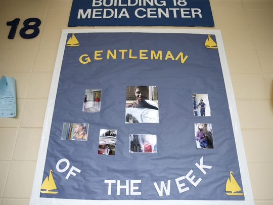 """A sign hanging in the halls at Rickards High School celebrates those honored as """"Gentlemen of the Week."""""""