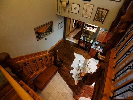 A balcony overlooks the study of the short-term rental property called Beaverdale Lodge Tuesday, Dec. 1, 2015 in Des Moines.