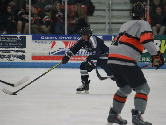 Mike Racioppi (5) of Middletown South.