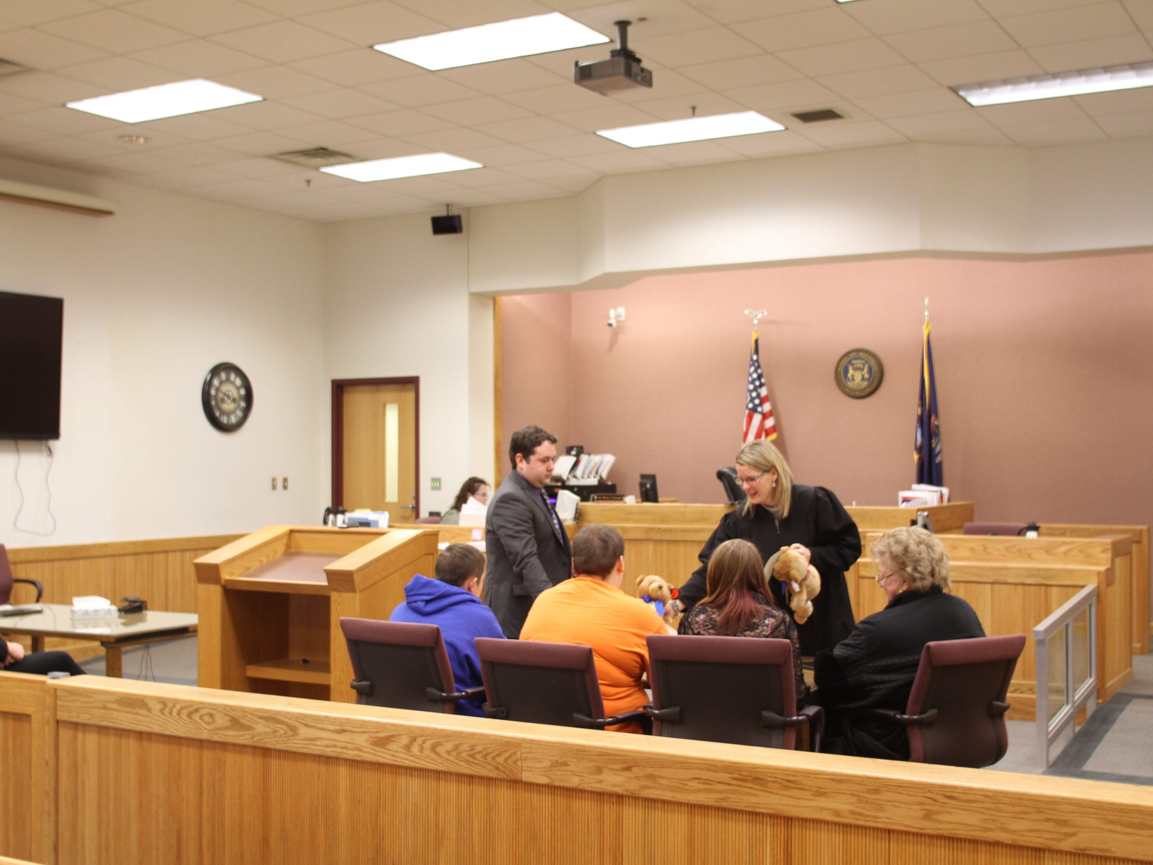 Judge Miriam Cavanaugh presents, from left, Lucas Scott,