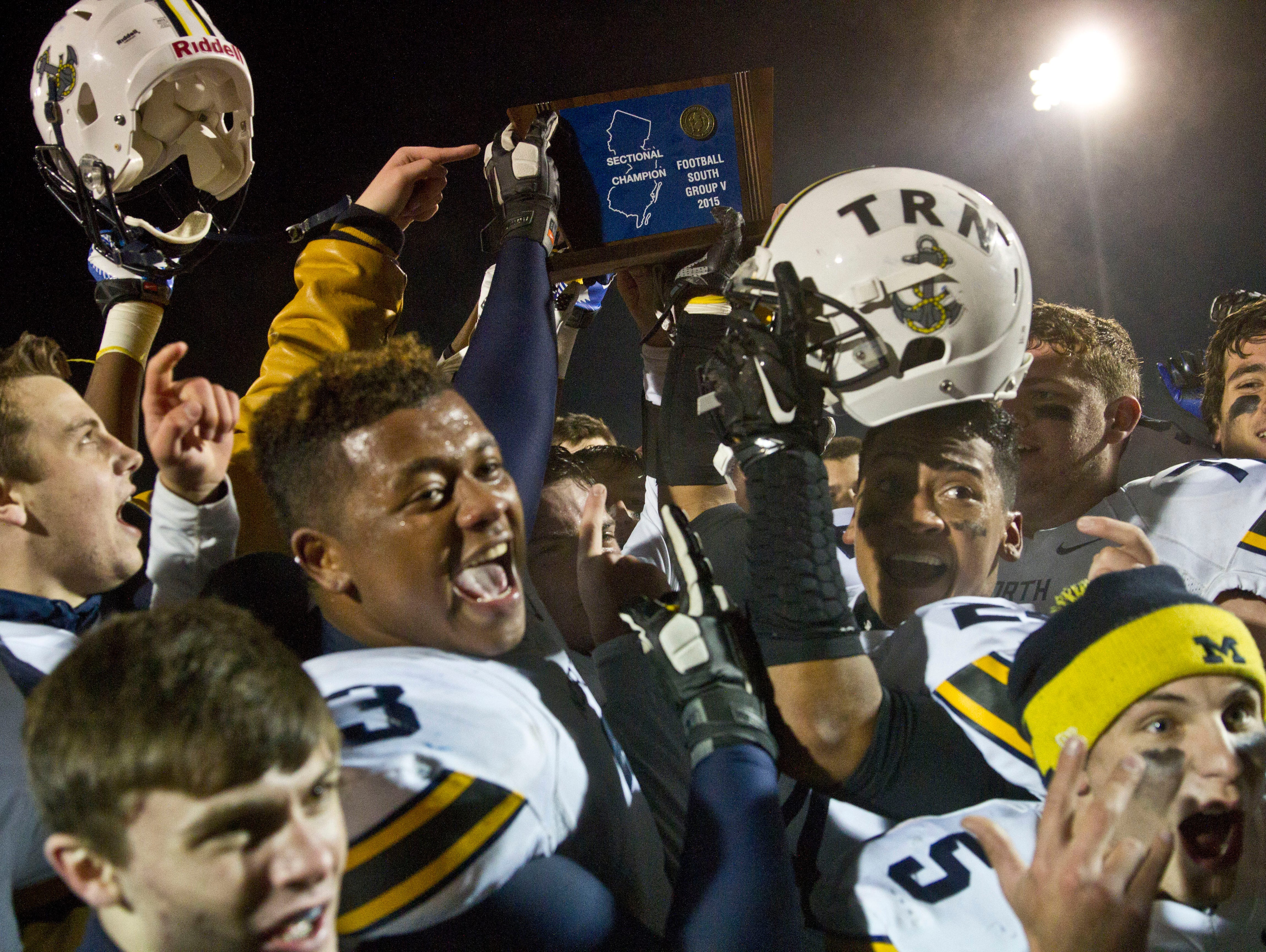 Toms River North celebrates the win. Toms River North defeats Williamstown for the NJSIAA Group V State Championship title. Glassboro, NJ Saturday, December 5, 2015 @dhoodhood