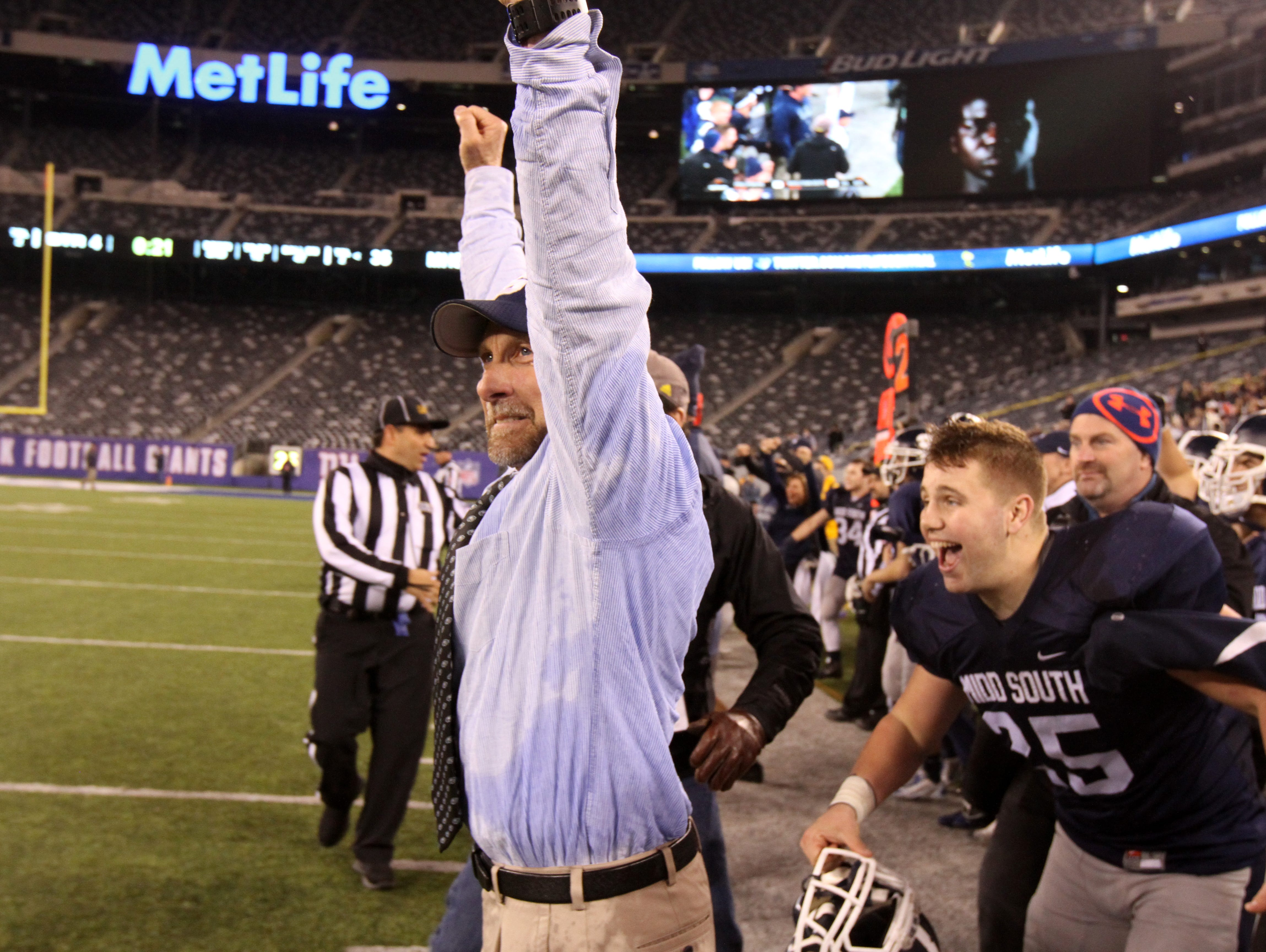 Middletown South High School head coach Steve Antonucci celebrates winning the state title against Phillipsburg in the North 2 Group IV game of the 2015 NJSIAA/MetLife Stadium High School Football Championships at MetLife Stadium in East Rutherford, NJ Saturday December 5, 2015.