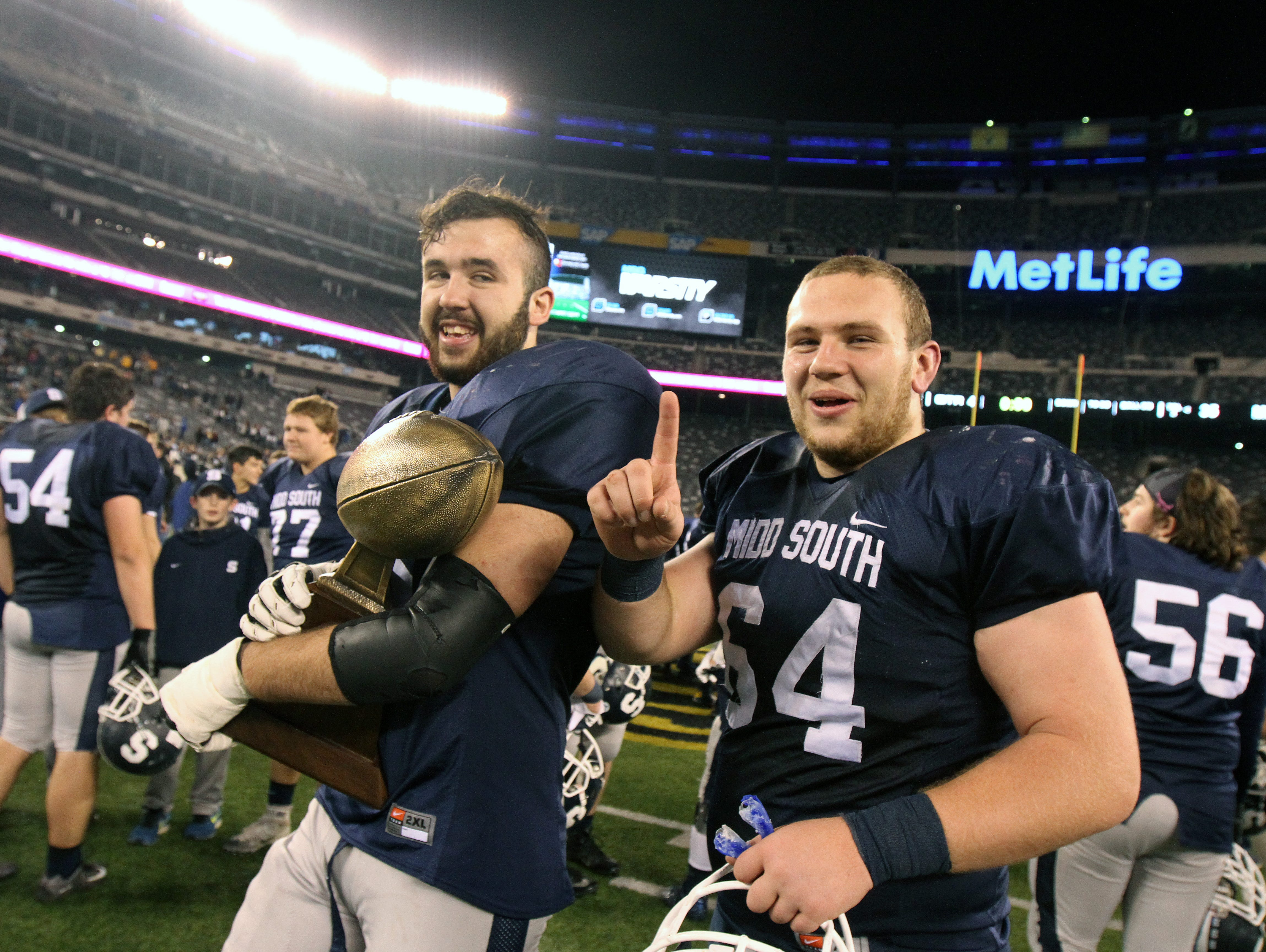 Middletown South High School football team celebrates winning the state title against Phillipsburg in the North 2 Group IV game of the 2015 NJSIAA/MetLife Stadium High School Football Championships at MetLife Stadium in East Rutherford, NJ Saturday December 5, 2015.