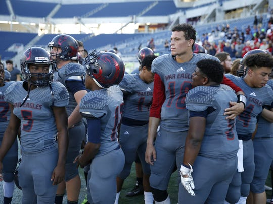 Wakulla teammates comfort each other after a close loss to the Bishop Moore Hornets of Orlando during their Class 5A State Title game at the Citrus Bowl on Friday.