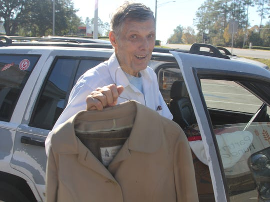 Maury Haggerman drops of warm clothing on his second trip during Saturday's Blanket Day.