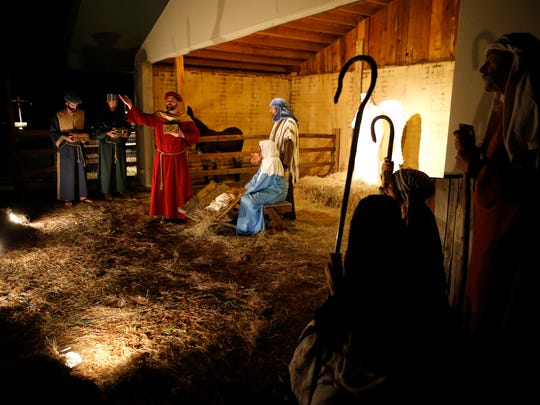 Church members portray Mary and Joseph in the manger scene with baby Jesus and the three wise men for the Living Christmas Story at Killearn United Methodist Church.