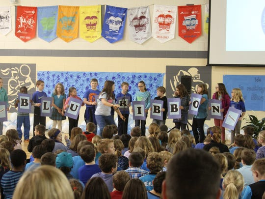Davis Elementary students spell out Blue Ribbon during a special assembly at the school on Tuesday, Dec. 15, honoring students, faculty, staff and the community for the school being named a Blue Ribbon School.