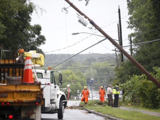 Workers inspect a downed power line on Thomasville Road following an April storm.