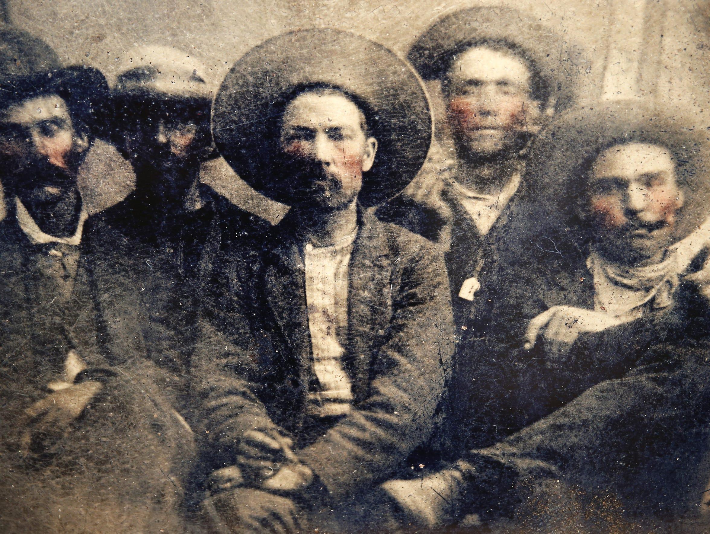The men in the photo are:  Far left: Pat Garrett; middle: