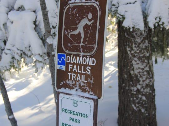 From the summer parking lot at Salt Creek Falls Trail, a sign marks the beginning of Diamond Creek Falls Trail. Photo taken Jan. 15, 2013.