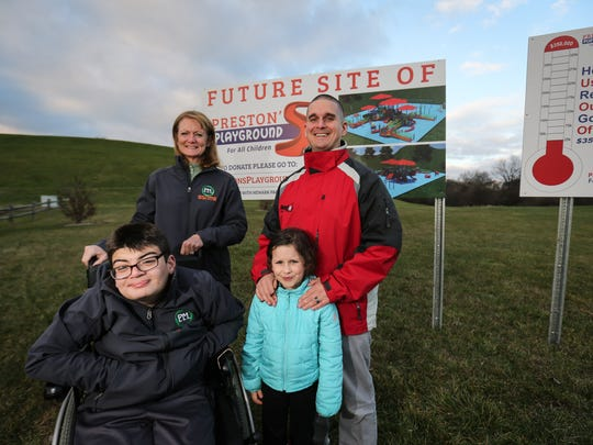 17-year-old Preston Buenaga, Deb Buenaga, 6-year-old Josephine DeCaire and Nic DeCaire stand in front of the future site of Preston's Playground, an adaptive playground to be built at the Newark Reservoir.