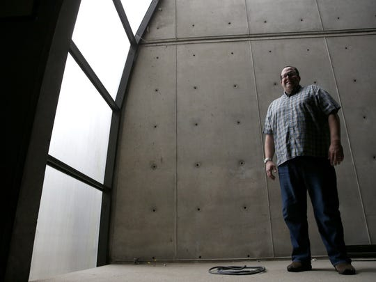 """Rev. Mike Toluba stands inside the of the former site of Wesley Foundation chapel at FSU on Wednesday, Dec. 16, 2015. The chapel, which was built in a """"brutalist"""" architecture style. The building is set to be demolished later this month and a new, modern looking building will be built in its place."""