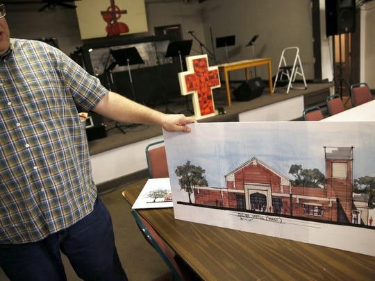 Rev. Mike Toluba shows off plans for a new chapel on FSU's campus for the Wesley Foundation Wednesday, Dec. 16, 2015. The current chapel is set to be demolished Wednesday.