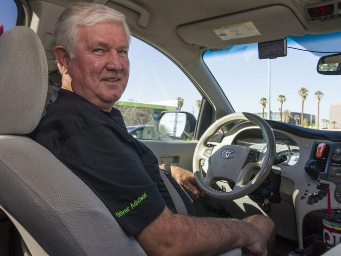 Glendale cab driver Al Tracy poses in Phoenix on Thursday,