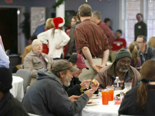 Guests sit down to a free Christmas dinner at Trinity