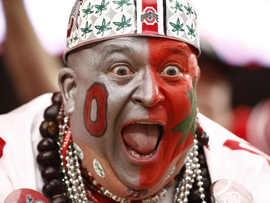 """Ohio State fan Jon """"The Big Nut"""" Peters celebrates a Buckeyes touchdown in the second half against Notre Dame at the Fiesta Bowl on Jan. 1, 2016 in Glendale, Ariz."""
