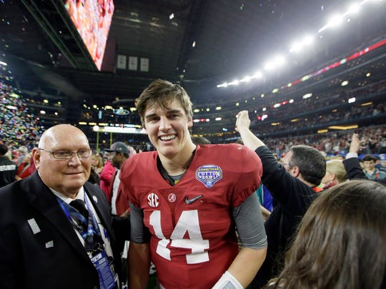 Alabama quarterback Jake Coker (14) smiles after the Cotton Bowl NCAA college football semifinal playoff game against Michigan State, Thursday, Dec. 31, 2015, in Arlington, Texas. Alabama won 38-0 to advance to the championship game. (AP Photo/LM Otero)