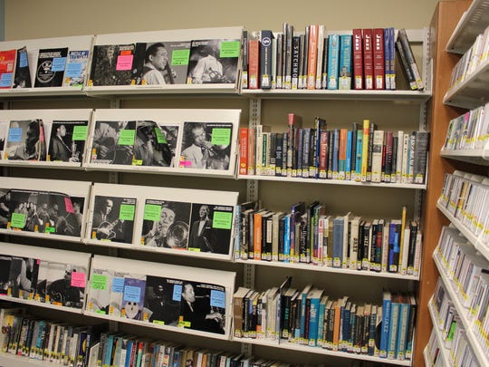 A corner of the small jazz room, full of CDs, books, biographies and reference materials, on the second floor of the West Florida Public Library on North Spring Street.