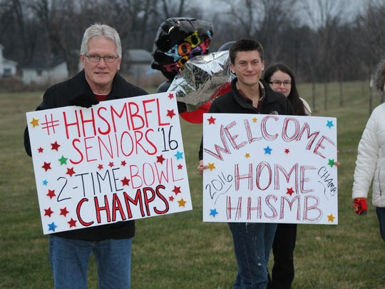 Proud family members wait for the Harding High School Marching Band to return to Marion on Sunday evening.