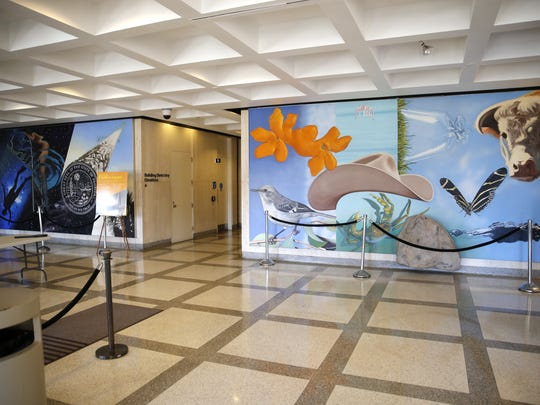 """James Rosenquist's murals, two """"Images of the Sunshine State"""" portray recreation and industry in Florida at the Captitol building's entrance."""
