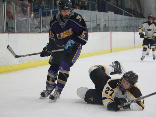 Alex Phipps (15) of St. Rose lays a hit
