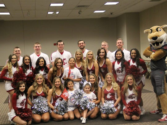 The Washington State Cougars cheerleaders and mascot