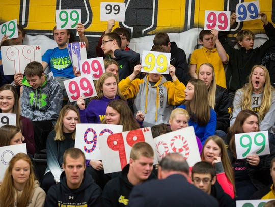 Students hold 99 signs for Republican presidential