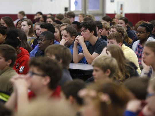 "Montford Middle School students listen to speaker Pieter Kohnstam, author of the book ""A Chance to Live: A Family'€™s Journey to Freedom™,"" on Friday."