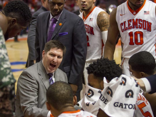 Clemson head coach Brad Brownell talks to his team during a timeout.