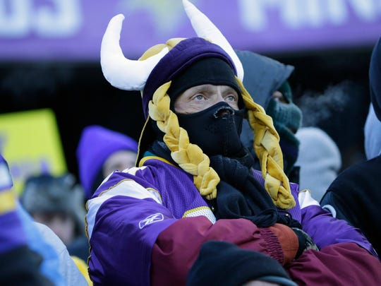 A Minnesota Vikings fan, dressed for the cold weather, watches the action during the second half Sunday, Jan. 10,  in Minneapolis.