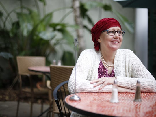 "Carrie Venclauskas, who the previous day went through her final round of chemotherapy for breast cancer, sits at Paisley Cafe on Sunday, she attends monthly Joanna Francis cancer support group meetings. ""The support group meetings became my safe escape from everything, it's a group of women that accepts me completely. I can complain about this crap if I want or I can make stupid jokes that only they will get,"" says Venclauskas. ""I can just be whatever I want without having to explain it and that has become important and special to me."""