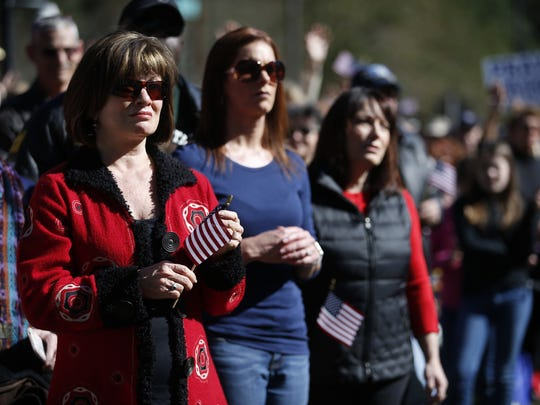 Attendees held American flags and signs in support of Franklin Graham.