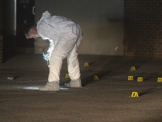 Clarksville Police collect evidence outside a College