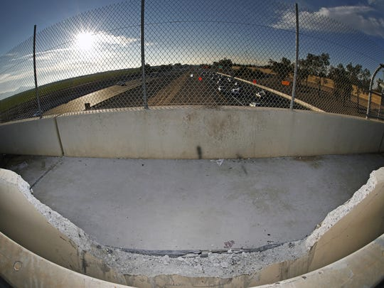 The broken barrier where a vehicle crashed through