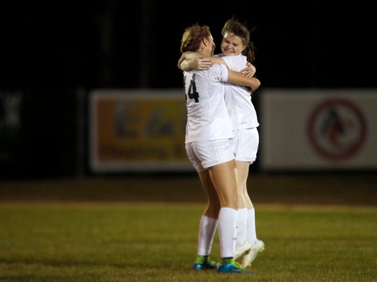 Maclay's Katie Lynch and Julianna Heuchan after Lynch scored a goal against Rocky Bayou during their district 1-1A final at Maclay High School on Friday.