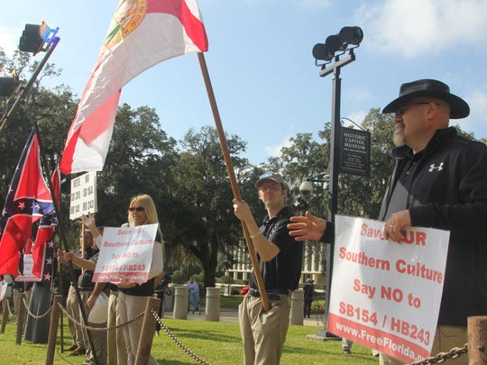 League of the South members gather at the Florida Capitol in protest of legislation they said would curtail their rights to fly the Confederate flag.