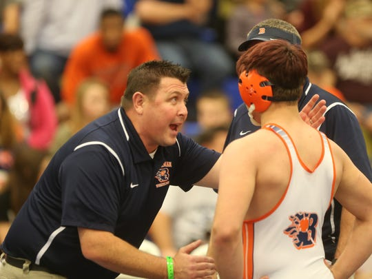 Blackman coach Ronnie Bray gives instruction to Hunter Winters during the G.P. West Invitational. Winters' brother Daniel died nearly a year ago in a car accident.