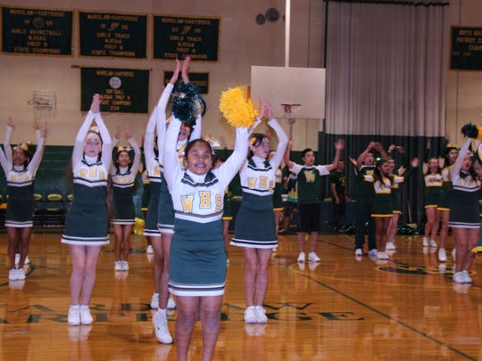 Cheerleaders at The Wardlaw-Hartridge School in Edison rally the community at the Winter Pep Rally on Jan.8.
