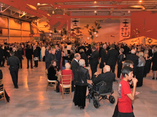 A cocktail reception at the Pond Hangar.